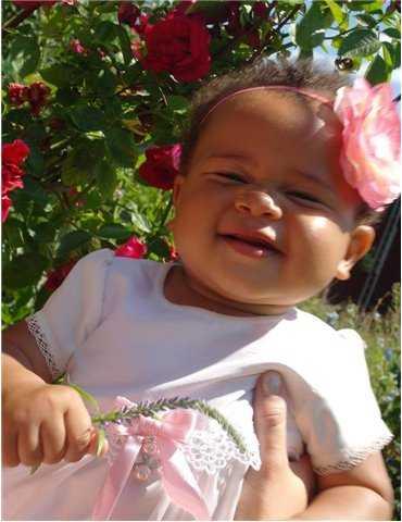 Dopklänning i kunglig stil med blå rosett