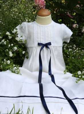 white christening gown with navy blue bow