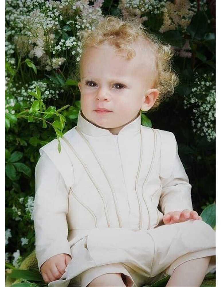 girl in christening bonnet and baptismal dress