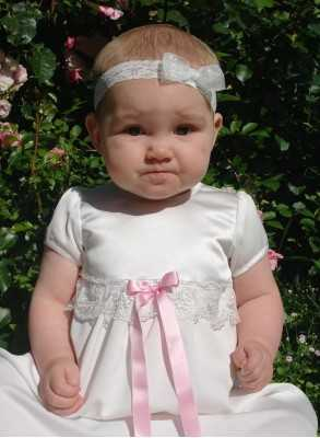 Christening gown Grace-Sessan in tulle lace and pink bow ribbons