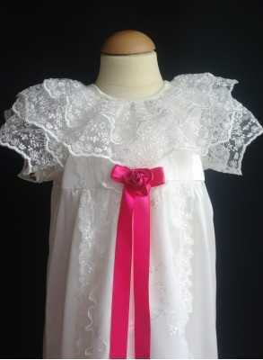 christening gown with unique lace and ceris bow