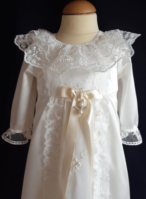 christening gown in lace with long sleeves