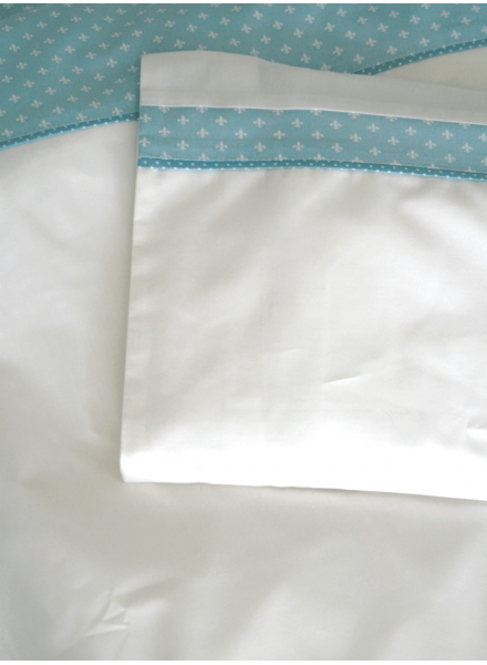 Handmade baby sheets and pillow in baby blue