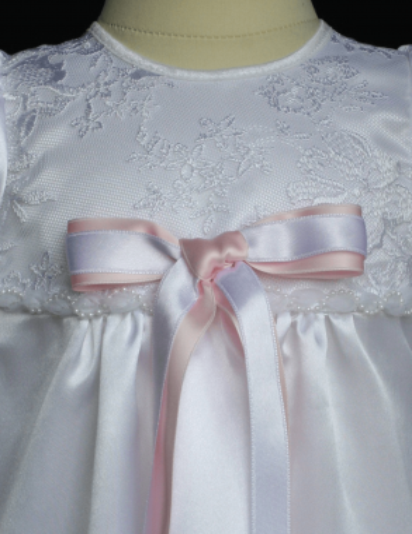 white christening dress with luxury rosette