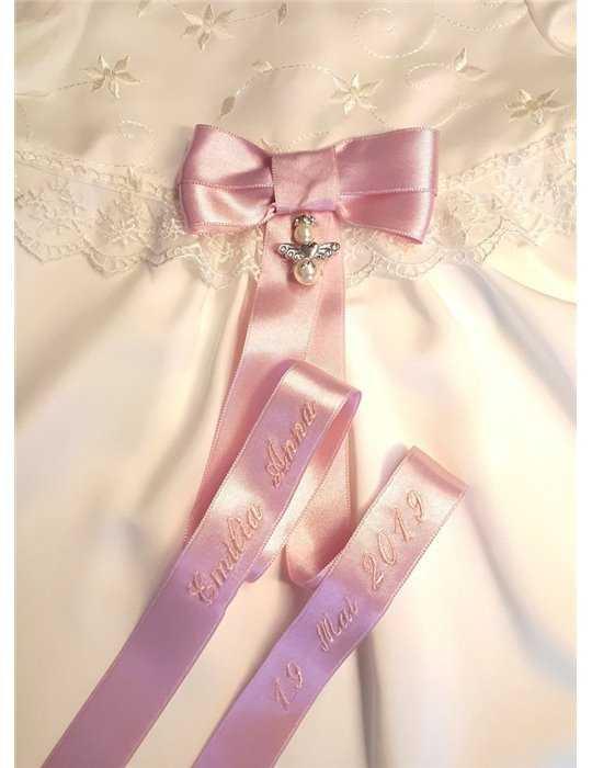 Dopklänning med lyxrosett