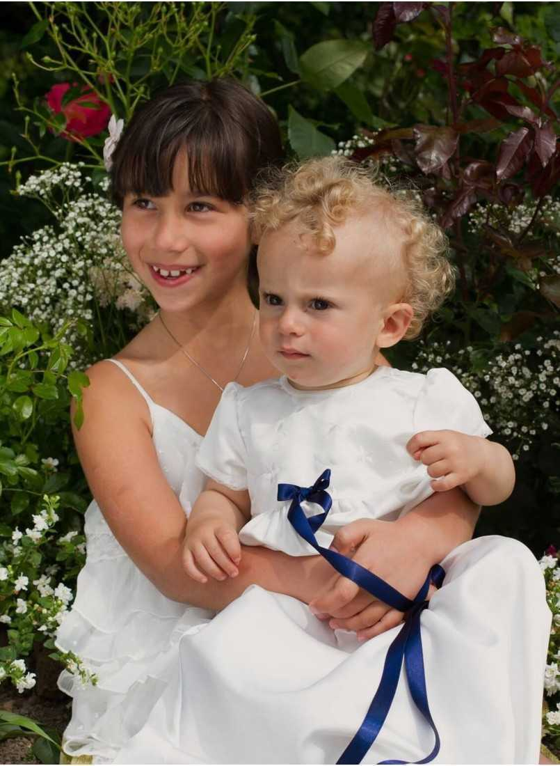 the sweetest sibling couple in baptismal wear