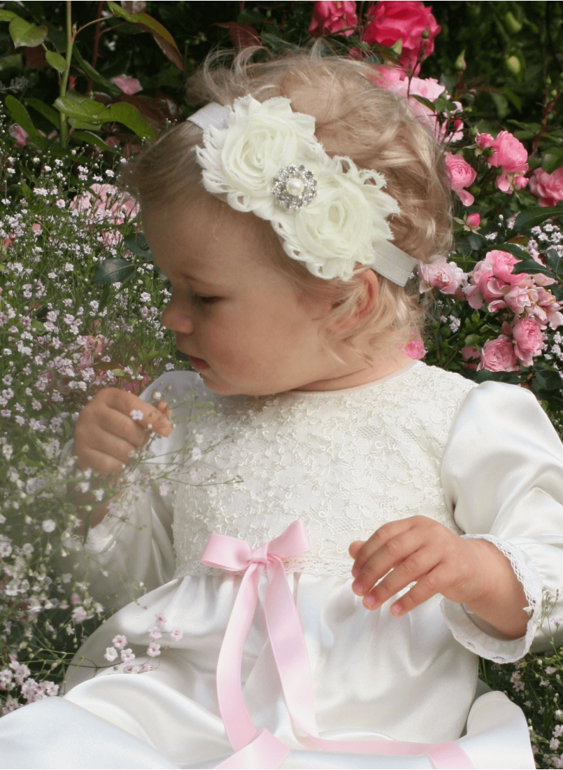 baby in christening gown with luxurious diadem