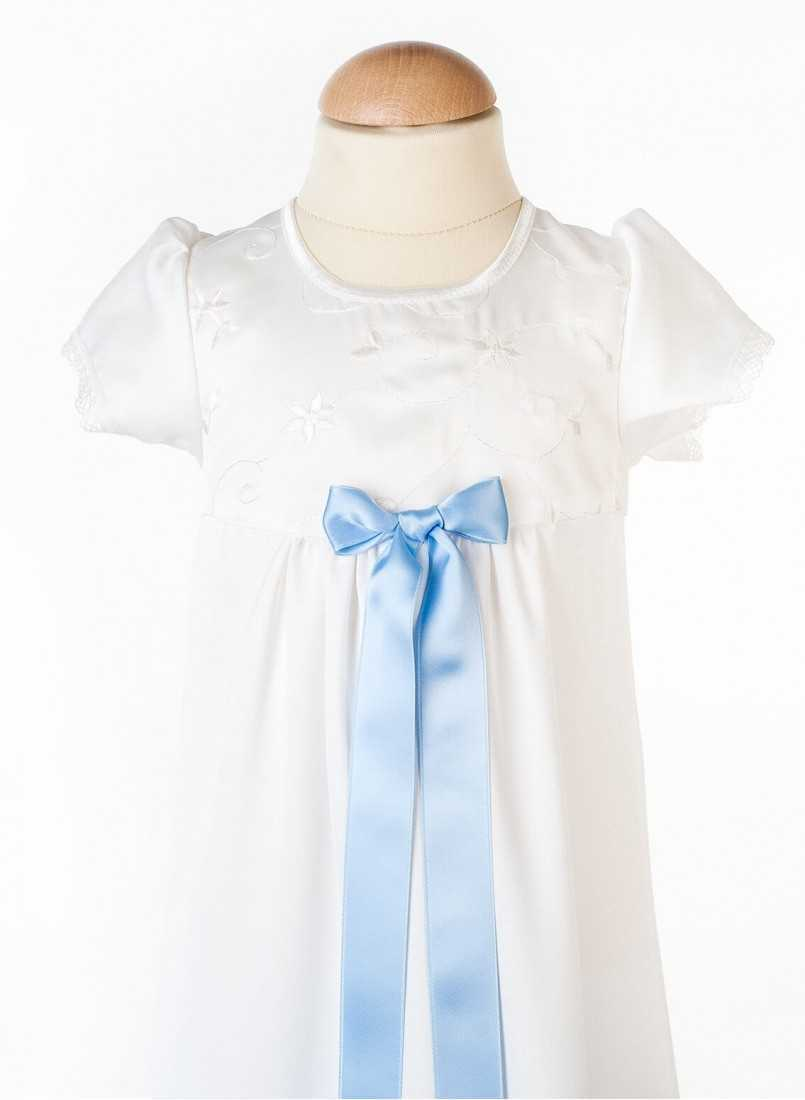 close up on Baptism gown in unisex model