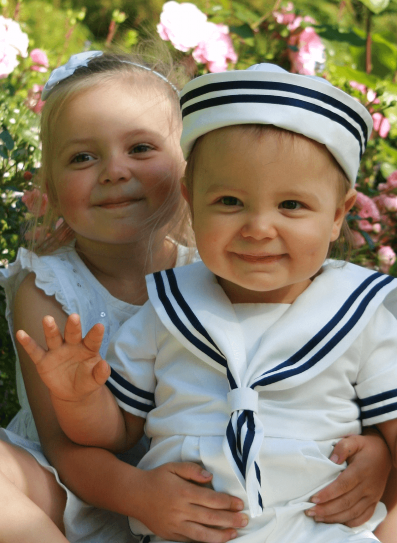 Sailor suite on cute guy and proud sister