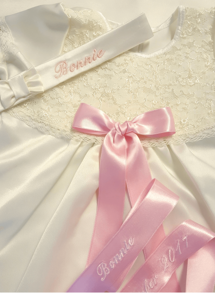 headband with embroidery and pink baptismal bow