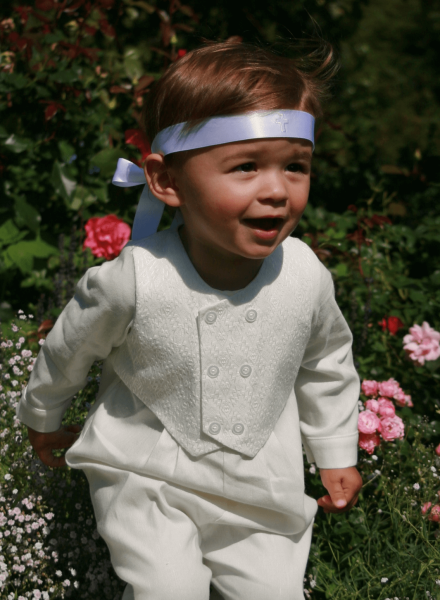 boy in white christening clothes