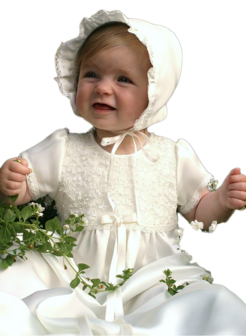 happy girl in shiny christening gown