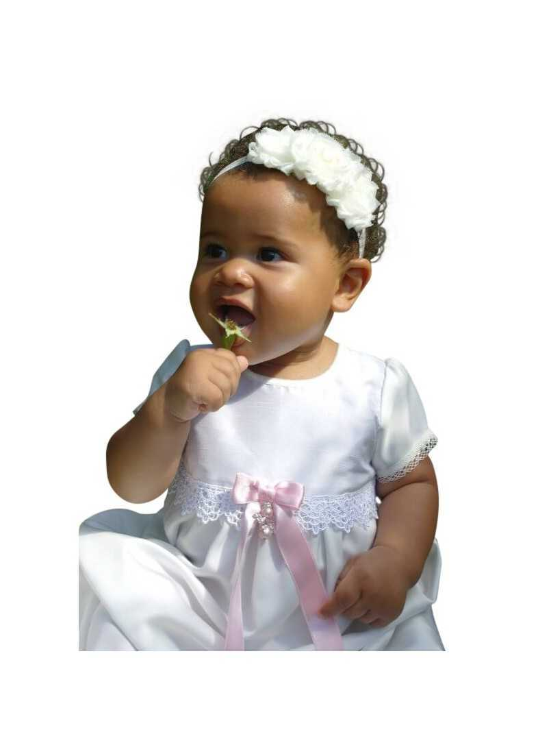 cute baby in princess baptism gown