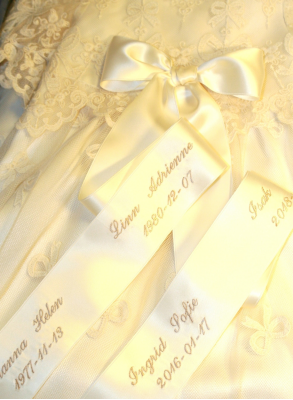 Bow embroidery on luxurious silk ribbon