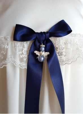 Guardian Angel to christening gown with navy blue baptism bow for boys