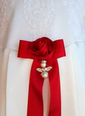Guardian Angel to christening gown with red rose bow