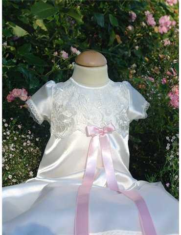 Dopklänning  i vitt tyg med marinblå rosett