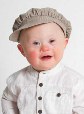 cute boy with don syndrom Christening bonnet in linen in Cap model for boys