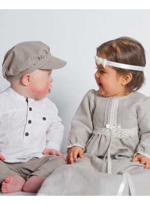 sweet boy and girl in natured colour linen for there baptism day